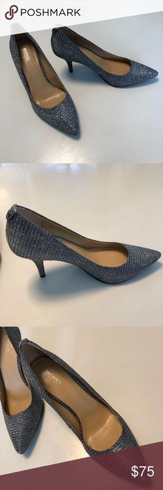 Michael Kors silver/grey pumps Michael by Michael Kors Silver pumps Size 9M Great silver pumps.  Not to shiny.  The color comes across as a silvery grey with some black.   They have only been worn once to an inside event.   Literally from the hotel room to the ball room. Michael Kors Shoes Heels