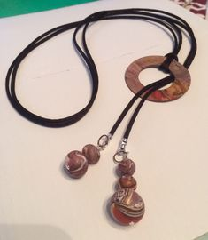 DIY lariat necklace. Polymer clay beads and hoop.
