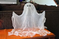 "Spray starch ghost. Drape gauze over a ghost ""form"" (liter bottle for body, Styrofoam head, wire for arms), spray with starch, allow to dry."
