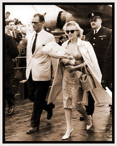 Marilyn Monroe and her husband, playwright Arthur Miller, arrive at London airport, England, July 14, 1956 !