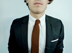 rusty knit tie with charcoal suit is a great combination.