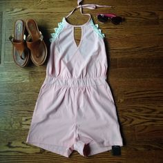 Romper Size S New With Tags! Super cute and on trend size small romper. 100% poly with lace detail and gorgeous open back and zipper. Pockets and cross cross front with adjustable ties for the perfect fit! Nadasha Pants Jumpsuits & Rompers