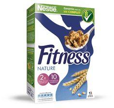 Boite de 375 gr Pétales de céréales et pétales de céréales enrobés de pâte de chocolat au lait saveur noisette (29%) enrichis en 5 vitamines, calcium, fer