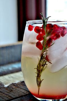 Pomegranate and Rosemary White Sangria | http://www.bakeaholicmama.com/2013/11/pomegranate-and-rosemary-white-sangria.html