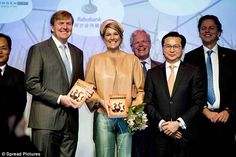 Maxima and Willem-Alexander are all smiles during their visit to the Sino-Dutch Dairy Development Center