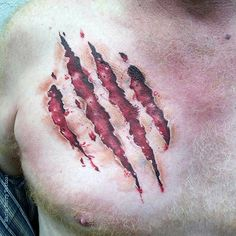 100 Bear Claw Tattoo Designs For Men – Sharp Ink Ideas Realistic Bear Claw Ripped Skin Male Chest Tattoos Skin Tear Tattoo, Ripped Skin Tattoo, Kratz Tattoo, Tiger Claw Tattoo, Body Art Tattoos, Sleeve Tattoos, Scratch Tattoo, Bear Paw Tattoos, Mark Tattoo