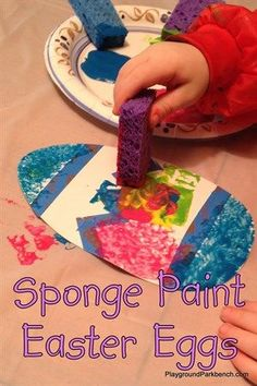 Tape off designs on cardstock Easter eggs and let your toddler paint them with sponges.  Great exploration of color, textures, and seasonal fun!