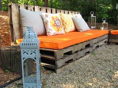 """Another view of my pallet """"sectional"""".  Next spring we will add more green plantings on the incline behind this section as well as perennials and potted annuals for color."""