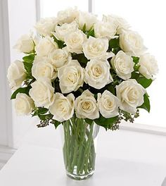 A less compact bouquet with white roses and greenery. -smaller version of that please for my bouquet White Rose Bouquet, White Rose Flower, White Roses, Pink Roses, Rose Flower Arrangements, 12 Roses, Rose Vase, Order Flowers Online, Sympathy Flowers
