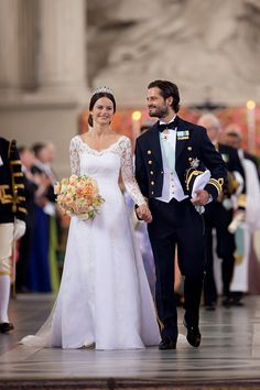 Prince Carl Philip of Sweden is seen with his new wife Princess Sofia of Sweden after their marriage ceremony on June 13, 2015 in Stockholm, Sweden.