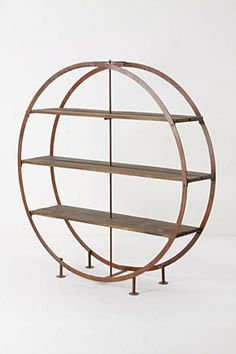 I'm curiously attracted to this bookcase.  Would look great in a room with round clocks and portholes.