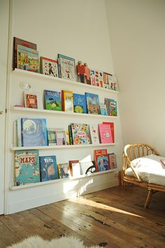 books displayed on shallow IKEA shelves http://www.designsponge.com/2014/10/a-harmonious-retreat-in-the-heart-of-amsterdam.html#more-207654