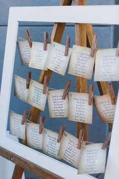 Unique seating chart idea - seating chart + paper escort cards displayed on a wooden ease attached to a line with clothespins {Two Foxes Photography}