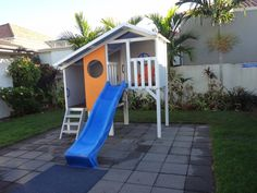 Duplex with porthole panel. Kids. Cubby house. Play. Outdoor fun. Slide. Blue.