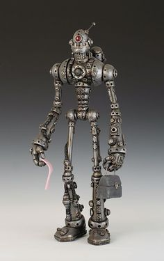 """""""Obsolete"""", polymer clay, 17″ tall.  By Kevin Reaves in his Automated Humanity robot collection."""
