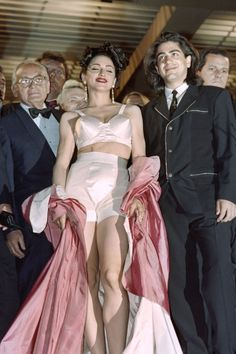 Madonna attended the Cannes Film Festival for the first time in 1991 to screen her film, In Bed With Madonna. The pop singer dressed the part in a pink silk robe, which she dropped at the end of the screening to reveal another Jean Paul Gaultier-designed cone bra and matching briefs.