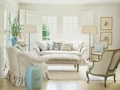 Neutral living room with accents of powdery blue. A lot of beautiful ideas here. Image found @ enchantedhome.com/2011/06/fabulously-french/