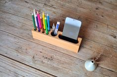 Store your phone as well as your best pen collection on one Wood Phone Holder & Pen Container.