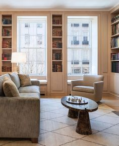 A living room on the Upper East Side that is all about subtle formal statements and geometries: the built-in bookshelves, deep windows, the… City Living, Living Rooms, Upper East Side, Work Spaces, Built Ins, Bookshelves, Home Office, Neutral, Deep