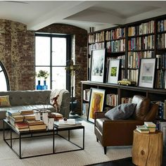 Oh how I would love to have floor to ceiling bookcases in my basement, stuffed with books!  And I love that shelf for displaying artwork....dreamin'