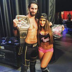 The WWE World Heavyweight Champion Seth Rollins & The Divas Champion Nikki Bella