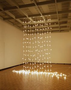 "Felix Gonzalez-Torres, ""Untitled"" (North), 1993. Light bulbs, extension cords, porcelain sockets."