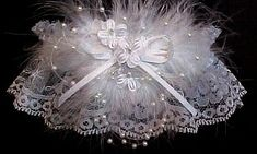 Unique Flights of Fancy on white lace - Bridal Garter. Floating pearls, forget-me-not flowers, and marabou feathers adorn this Wedding Bridal Garter from Custom Accessories Garters LLC. Style # W2-WF / Visit: www.garters.com/page16c.htm