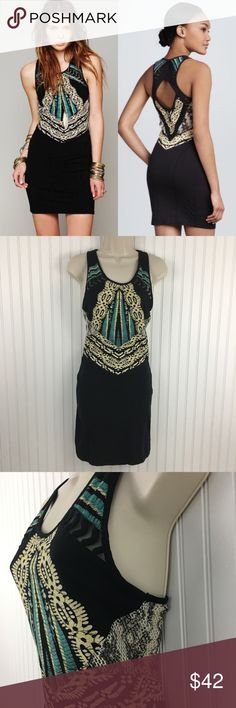 """Free People Out of Africa Cutout Bodycon dress This curve conforming jersey dress with Snake print mesh panels on the sides. Embroidered mesh bands frame a diamond cutout in back, and a mix of abstract prints details the bodice. Unlined. In very good condition no rips stains or holes Approximate measurements flat across Chest: 14.5""""  Waist: 12.5"""" Hips: 14.5"""" Length: 34"""" Free People Dresses Mini"""