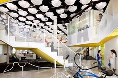Amazing office space!  Love the graphic treatments and the light fixtures/umbrellas!