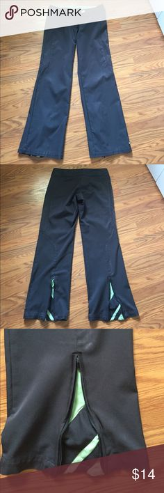"Nike workout pants Nike pants grey and green, one hook was sewn back on otherwise in good condition, inseam 29"" Nike Pants Track Pants & Joggers"