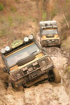 Pair of Camel Trophy Land Rover Defender's traversing Ruts