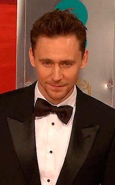 Tom Hiddleston posing sexy for photographers. Sample 4