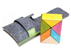 Pocket Pouch Prism When traveling with the fam, one thing is certain: You will be stuck — in traffic, at the airport, with bored kids. Which is why we're so attracted to the latest magnetic building set from Tegu. The six-block collection is made up of triangles and parallelograms that turn into everything from a dog to a rocket ship. Available at tegu.com, $30.