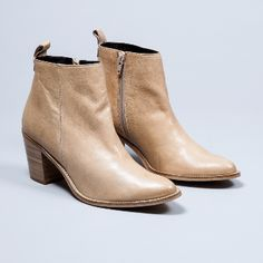 Gardenia  Women's Beige Pointed Toe Side Zip Boots: Beige pointed toe side zip boot. The upper leather is super sleek and exudes quality, whilst the wooden heel has bags of character that is perfect for making a statement in the evening.