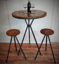 Spool top table bar height (or whatever height you want ....just let us know) x 29 -32 wide spool top, with set of two matching spool top stools on smooth brushed and sealed rebar legs. (The bottoms of legs are polished baby smooth so as to not scratch your floor but if you would
