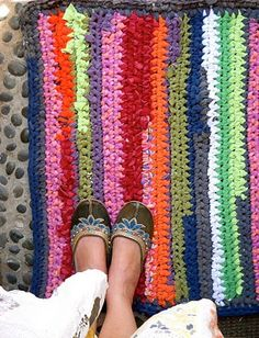 I crochet a lot, so crocheting together bits of old tees for a nice bath mat would be nice.