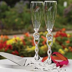 Love Knot Stem Flutes Silver-plated stems with tied knot design.
