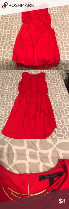 BCBG red dress worn once There's a barely noticeable stain near the neckline. This may come out with a bit of scrubbing. The dress was worn only once and has been cleaned since then. BCBGMaxAzria Dresses