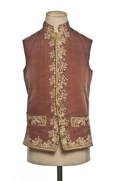 Waistcoat, France, 1774-1789. Pale red faille silk embroidered along the front edges and collar with bright silk in a floral design.