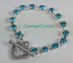 """Sparkling Turquoise Crystal Tennis Bracelet with Pebble Textured Heart Toggle Clasp. Small 6 1/2"""" Wrist. by SpangleCrystals on Etsy"""