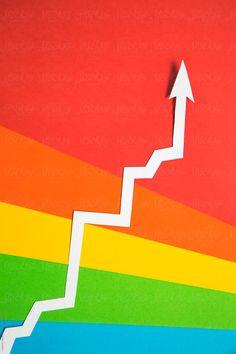 White arrow heading upward on rainbow background. by Catherine MacBride - Stocksy United Money Images, Us Images, Rainbow Paper, Rainbow Background, Chevrolet Logo, Design Elements, Arrow, The Unit, Stock Photos