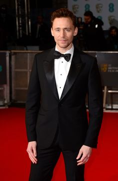 Tom Hiddleston attends the EE British Academy Film Awards at The Royal Opera House on February 8, 2015 in London, England    I love it when his tie is crooked.  Holy cannoli!