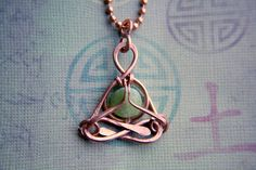 yoga jewelry , Little Jade Yogi pendant, meditation, Lotus, Gasho, mudra, namaste, zen, heart chakra, green eco, recycled, lemurian diamond. $30.00, via Etsy.