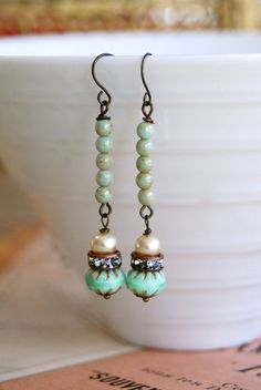Gretchen.pearl,rhinestone,green beaded earrings. Tiedupmemories. $18.00, via Etsy.