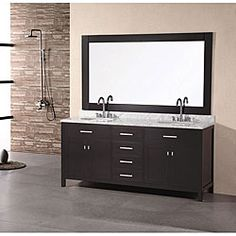 Transform your bathroom with the sleek, contemporary styling of this London vanity set. This double-sink bathroom vanity features a solid oak base and marble counter top.