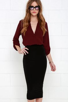 Sleek and stretchy poly shapes this wardrobe essential with a high, banded waist, bodycon fit, and on-trend midi length.