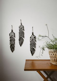 FEATHER WALL DECORATION...would be cool to make out of foam board
