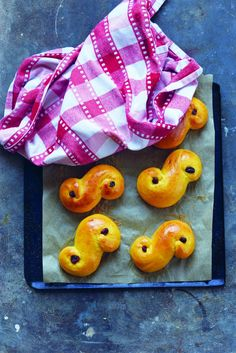 Lussebullar - Lucia Celebration Saffron Buns Scandinavians celebrate St. Lucia's Day on 13th December – the day we wake up early and sing the light into the darkness. Processions of children in white robes tied with red sashes ...