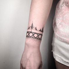 I like the idea of a patterned wrist tattoo