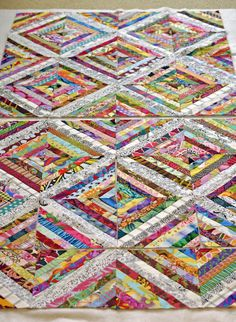 String Quilt by inquilternity. I like this one a lot because the lighter borders allow the eyes to rest. Most of the time these types of string quilts are all in your face color. Nice job.